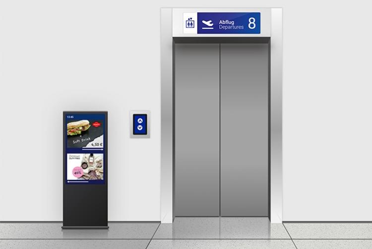 multimedia display in an airport elevator